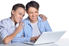 Portrait of fine family with laptop on white background stock photography