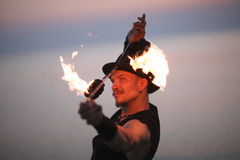 Portrait of fire dancer spinning poins over his he Royalty Free Stock Images