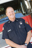Portrait of a firefighter by a fire engine royalty free stock photography