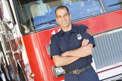 Portrait of a firefighter by a fire engine stock photo