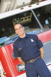 Portrait of a firefighter by a fire engine stock images