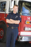 Portrait of a firefighter by a fire engine Royalty Free Stock Photo