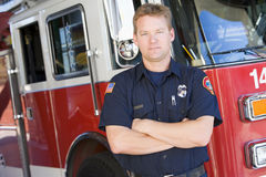 Portrait of a firefighter by a fire engine Royalty Free Stock Photos