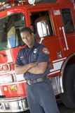 Portrait of a firefighter by a fire engine Royalty Free Stock Image
