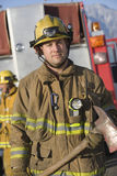 Portrait Of A Firefighter Holding Axe Stock Photos