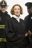 Portrait of a firefighter a judge and a police officer Stock Photography
