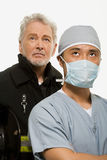 Portrait of a firefighter and a surgeon Royalty Free Stock Photo