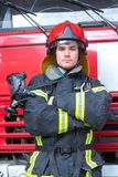 Portrait of a fireman. With car on background Stock Photo