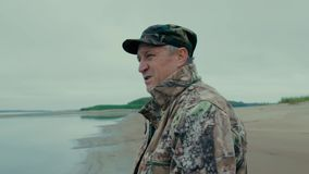 Portrait of a fisherman. Close-up in profile on the river stock video footage
