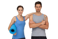 Portrait of a fit couple with exercise mat and water bottle Royalty Free Stock Images