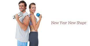 Portrait of a fit couple exercising with dumbbell Stock Images