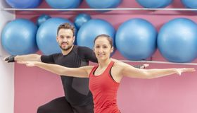 Portrait of a Fit Couple. In a gym. Selective focus on the women with braces Stock Photography