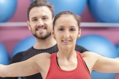 Portrait of a Fit Couple. In a gym. Slective focus on the women with braces Royalty Free Stock Photos