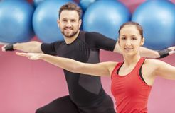 Portrait of a Fit Couple. In a gym. Selective focus on the women with braces Stock Image