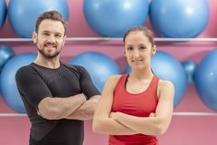 Portrait of a Fit Couple. In a gym. Slective focus on the women with braces Stock Photo