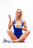 Portrait of a fit healthy woman eating a fresh salad. On white Royalty Free Stock Image