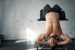Fit lean young man exercising in a gym. Portrait of a fit lean young man exercising in a gym Stock Images