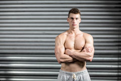 Portrait of fit man with crossed arms Stock Photo