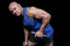 Portrait of fit man exercising with dumbbells Royalty Free Stock Photos