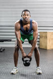Portrait of fit man lifting dumbbells Royalty Free Stock Photo