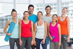 Portrait of fit people smiling in exercise room Stock Image
