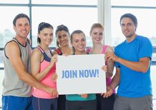Portrait of fit peoples showing join now card Royalty Free Stock Images