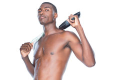 Portrait of a fit shirtless man holding frying pan Stock Photo