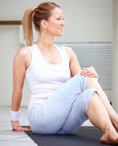 Portrait of fit woman sitting Stock Images
