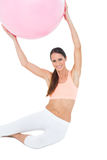 Portrait of a fit woman sitting with fitness ball Stock Images