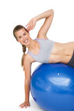 Portrait of a fit woman stretching on fitness ball Stock Image