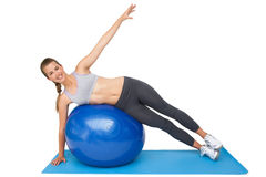 Portrait of a fit woman stretching on fitness ball Stock Images
