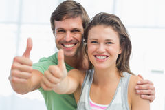 Portrait of a fit young couple gesturing thumbs up Stock Photo