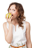 Portrait of fit young girl biting a fresh ripe apple Stock Photo