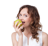 Portrait of fit young girl biting a fresh ripe apple Royalty Free Stock Photography