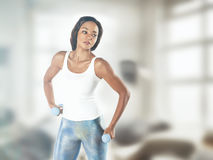 Portrait of a  fit young lady working out with dumbbells. Vintag Royalty Free Stock Image