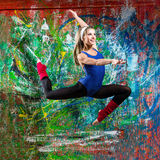 Portrait of fit young woman jumping Royalty Free Stock Photos