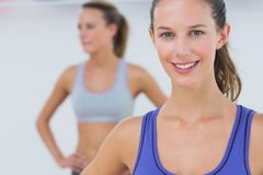 Portrait of fit young women in sports bra Stock Image