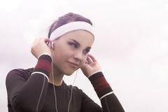 Portrait of Fitness Caucasian Woman Listening to Music during He Royalty Free Stock Image