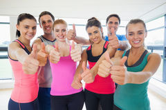 Portrait of fitness class gesturing thumbs up Royalty Free Stock Images
