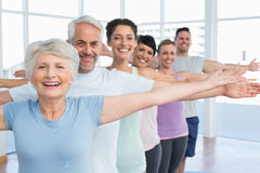 Portrait of fitness class stretching hands in row Royalty Free Stock Photo