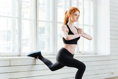 Portrait of a fitness girl doing stretching exercises Stock Photos