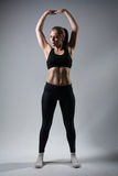 Portrait of fitness girl in full growth Royalty Free Stock Image