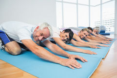 Portrait of fitness group bowing in row Royalty Free Stock Photo
