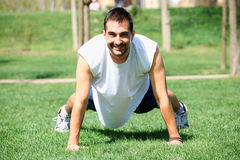 Portrait of a fitness man doing push ups Royalty Free Stock Photo