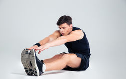 Portrait of a fitness man doing stretching exercises Royalty Free Stock Photo