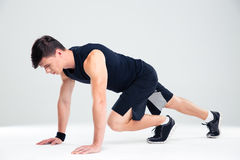 Portrait of a fitness man doing warm up exercises Royalty Free Stock Photography