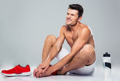 Portrait of a fitness man with foot pain Royalty Free Stock Image