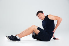 Portrait of a fitness man having back pain Royalty Free Stock Images