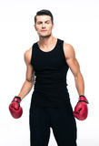 Portrait of a fitness man with red boxing gloves Stock Photos