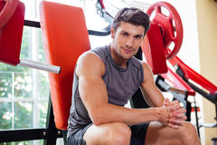 Portrait of a fitness man resting on bench at gym Royalty Free Stock Photo